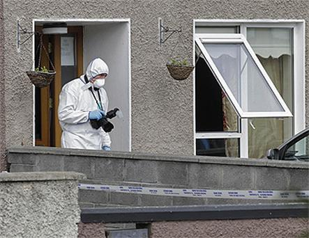Forensics officers at the scene on Shancastle Avenue, Clondalkin, west Dublin, where a 53-year-old was shot at around 4.05am this morning. Photo: PA