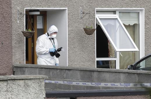 Gardai at the scene on Shancastle Avenue, Clondalkin, west Dublin, where a 53-year-old was shot at around 4.05am this morning. Photo: PA