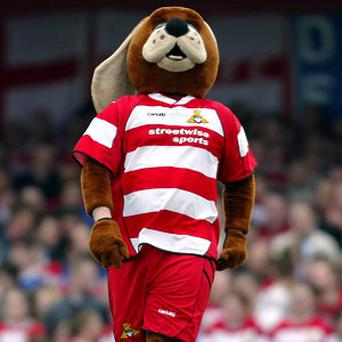 The face behind Doncaster Rovers' Donny Dog mascot has been sacked after a saucy photoshoot in a national newspaper