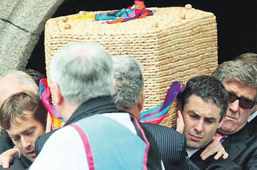 Mourners carry out the remains of former horse trainer Sue Doyle