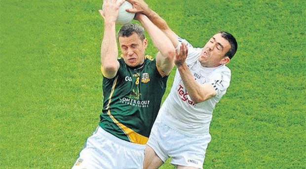 Kildare's John Doyle and Nigel Crawford of Meath contest the throw-in at the start of their Leinster SFC quarter-final at Croke Park
