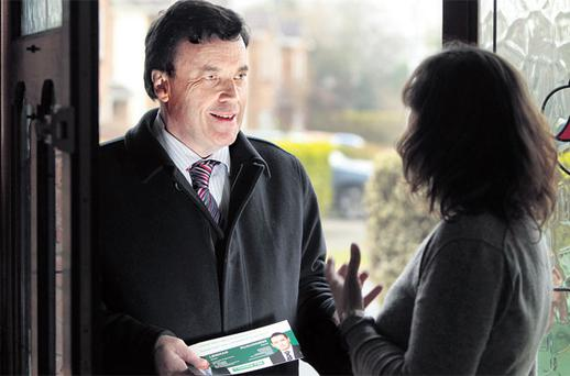 BORN POLITICIAN: Brian Lenihan with Fionnuala Lagan during an canvass in Clonsilla, west Dublin, ahead of February's general election. Photo: Gerry Mooney