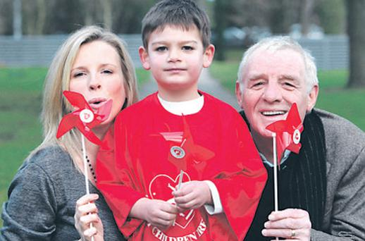Colette and Eamon Dunphy with Braiden