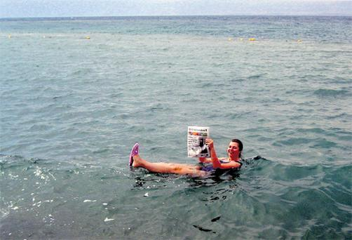 Chrissie floating on the Dead Sea