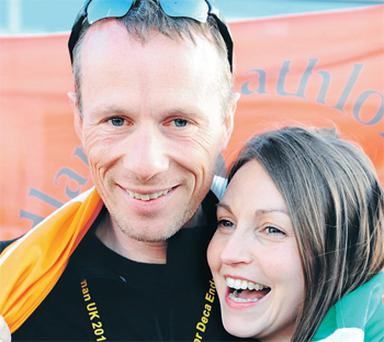 Deca Ironman champion Gerry Duffy with his girlfriend Jacinta O'Neill after arriving back in Dublin Airport last night