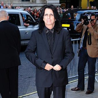Alice Cooper was given his gong for his four decades in the spotlight