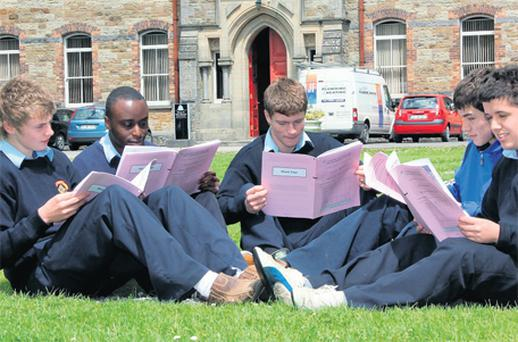 Students at St. Patrick's College, Cavan Daniel Talbot, Peter Sanya, Cahir O'Reilly, Johnny Galligan and Caolan McCarthy look pleased as they look over their Geography paper on Friday afternoon. Photo: Lorraine Teevan