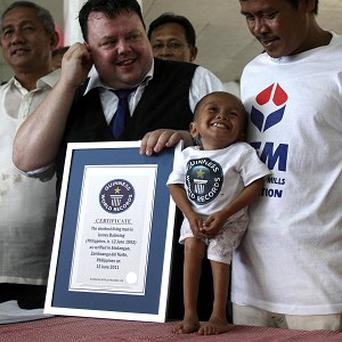 Junrey Balawing smiles as he is named the world's shortest living man (AP)