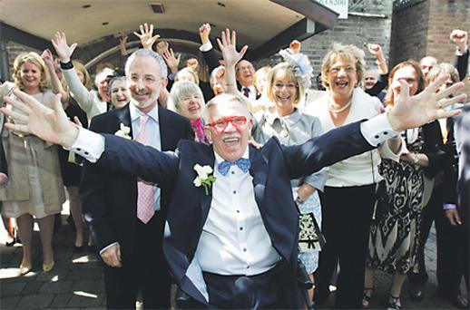 RTE broadcaster Michael Murphy and Terry O'Sullivan with their guests at Dublin's Registry Office yesterday