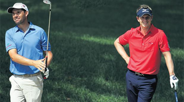 Padraig Harrignton and Luke Donald during yesterday's practice round ahead of the 111th US Open which starts at the Congressional Country Club in Maryland tomorrow