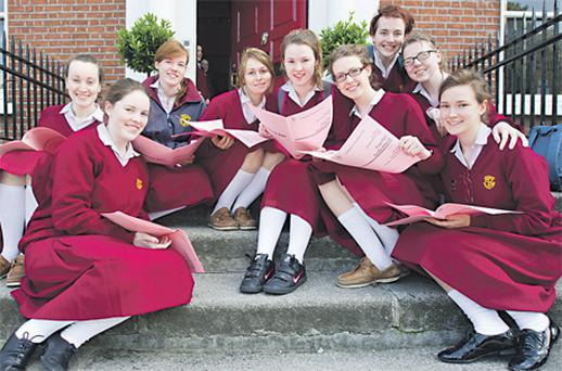 Brona Staunton, Aoife Lawlor, Laura Gaffney, Emily Campbell, Sinead Flynn, Mairead Conway, Rachel Fingleton, Joyce O'Reilly and Louise Murphy from Loreto College on Dublin's St Stephen's Green, go through their Leaving Cert Irish paper yesterday