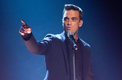 Robbie Williams was performing his solo slot on the reunited group's tour in Cardiff when disaster struck. Photo: Getty Images