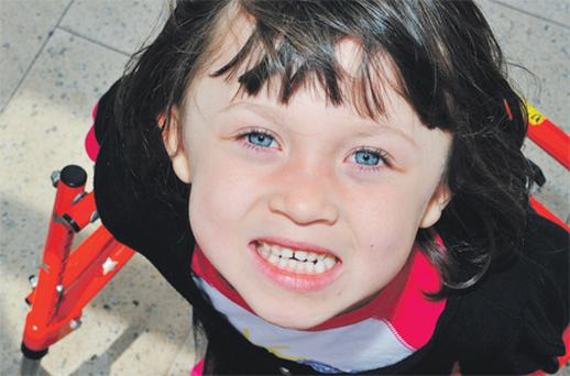 Casey Fitzgerald (5) relies on a walking frame and wheelchair
