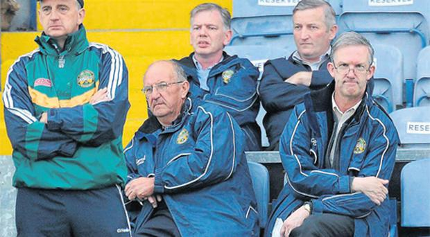 Offaly county board chairman Pat Teehan, right, and team secretary Tony Murphy watch Offaly in action against Carlow with team manager Joe Dooley during the Walsh Shield Final at O'Moore Park in Portlaoise last night