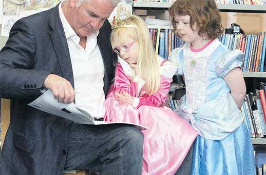On the same page: rugby pundit Brent Pope with Emily Breslin (4) and Niamh Doherty (5)