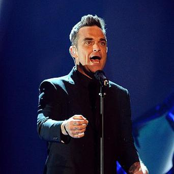 Robbie Williams went on singing despite his wardrobe mishap