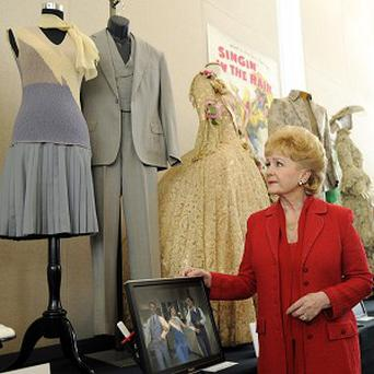 Debbie Reynolds looks up at the dress she wore for the Good Mornin' sequence in the 1952 film Singin' in the Rain