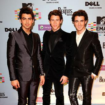 It's not the end of the Jonas Brothers, according to youngest brother Nick