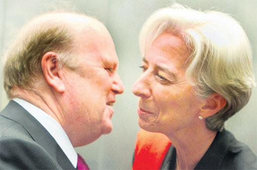 Finance Minister Michael Noonan greets French Finance Minister Christine Lagarde at the Eurogroup meeting of finance ministers in Luxembourg last night