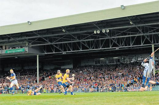 Tipperary's Lar Corbett beats Clare goalkeeper Philip Brennan to score his side's third goal in the Munster SHC semi-final at the Gaelic Grounds yesterday