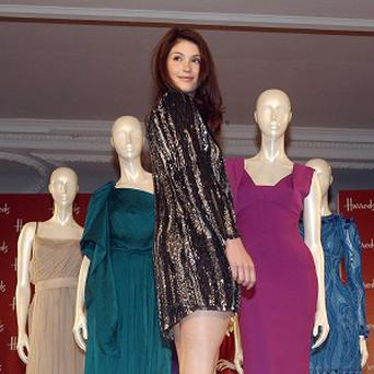 Gemma Arterton opens the Harrods Summer Sale in London