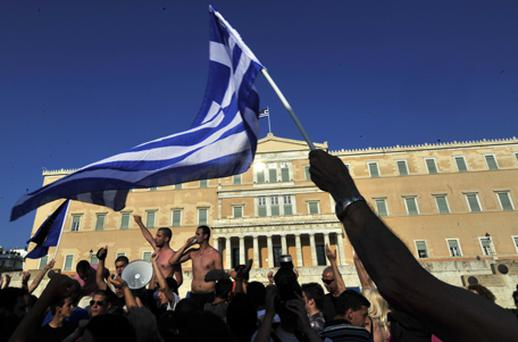 Greek 'Indignants' protest for the fourth consecutive week against new austerity measures in front of the Greek parliament. Photo: Getty Images
