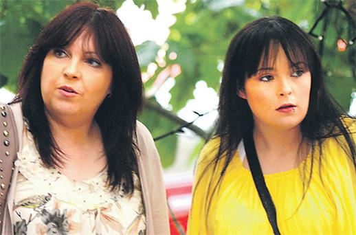 Mary Dunne and her daughter, Erica, leave the Employment Appeals Tribunal at the River Court Hotel in Kilkenny yesterday