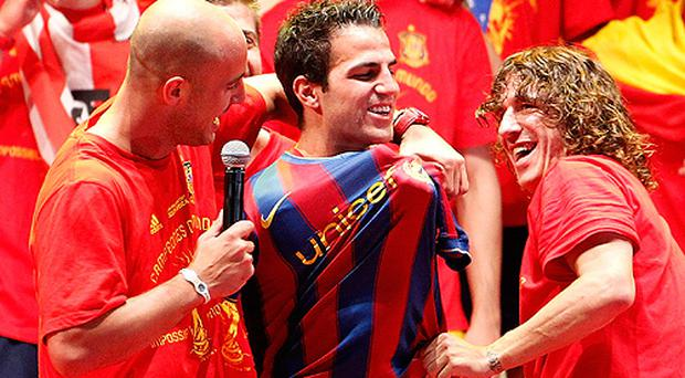 Cesc Fabregas, centre, pictured during celebrations following Spain's World Cup triumph when he had a Barcelona shirt put on him by his team mates. Photo: Getty Images