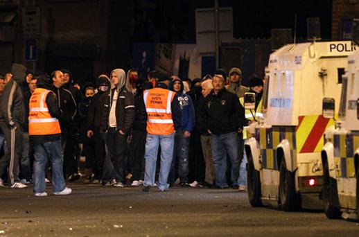 Loyalists gather in east Belfast, watched over by stewards near to the Short Strand area. Photo: Getty Images