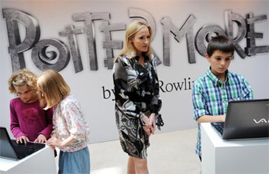 Harry Potter author JK Rowling watches young fans at the launch of her Pottermore website in London. Photo: PA