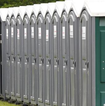 A woman discovered a man hiding in a tank below a portable toilet at a Colorado yoga festival