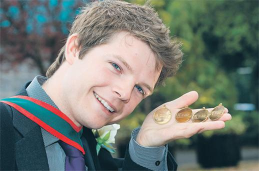 Gerard Healy, who was conferred yesterday, with the medals he won for coming top of his class in four subjects