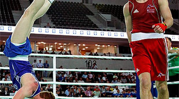 Ray Moylette preforms a handstand after winning the final against Thomas Stalke of England. Photo: Cathal Noonan