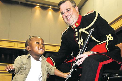 Myles Masuku (1) with Captain Declan Whitson of the Army Band. Photo: Mark Condren