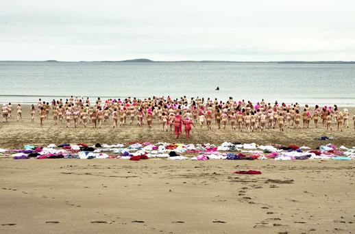 COME ON IN, THE WATER'S LOVELY: The female section of the 'Dip in the Nip' at Dunmoran Strand, Co Sligo, yesterday, in aid of cancer research. Photo: Frances Muldoon