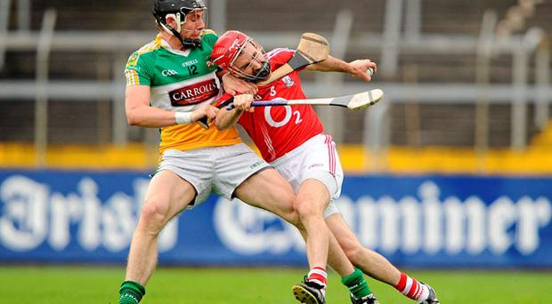 Determination is the name of the game as Conor Mahon (left) and Jerry O'Connor battle it out. Photo: BRENDAN MORAN / SPORTSFILE