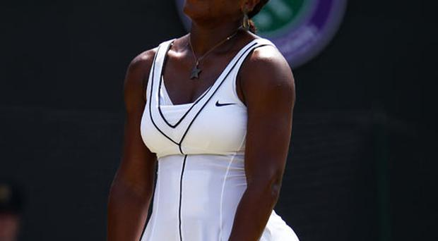 Serena Williams is out of Wimbledon after losing to Marion Bartoli. Photo: Getty Images