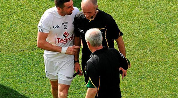 Kildare's Aindriu MacLochlain speaks to referee Cormac Reilly at the end of the game. Photo: Sportsfile