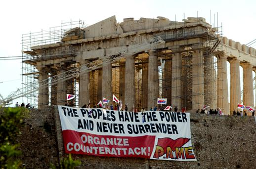 Greek protesters hold a huge banner in front of the Parthenon at the Acropolis hill in Athens on June 27. Photo: Getty Images