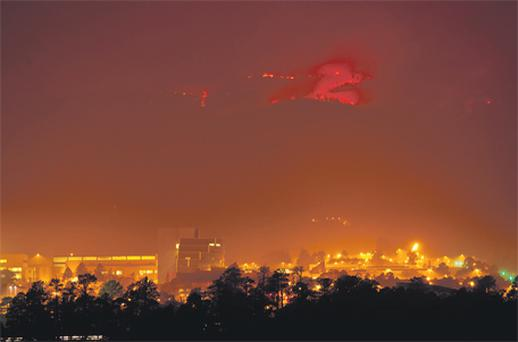 Flames from the Las Conchas fire in the hills above Los Alamos National Laboratory, a nuclear facility, on Monday