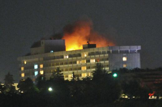 Smoke and flames light up the night from a blaze at the Intercontinental hotel after the Taliban attack. Photo: Getty Images