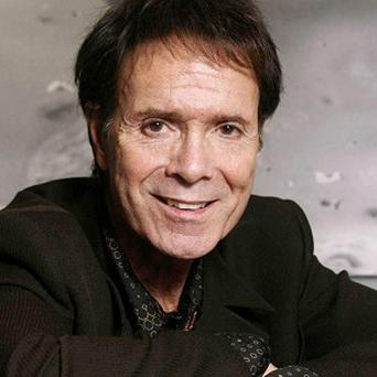 Sir Cliff Richard showed off his chef skills in Gus's Fried Chicken in Memphis, Tennessee