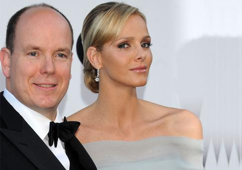 Monaco's Prince Albert II and his fiancee Charlene Wittstock. Photo: getty Images