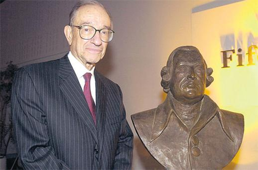 Alan Greenspan with a bronze bust of Adam Smith. One of these is revered as a titan of economics...