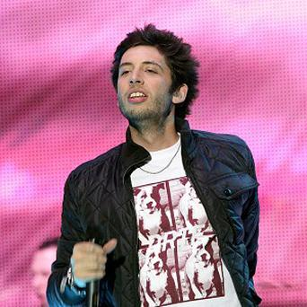Example said his Twitter row with Alexandra Burke helped sell his single