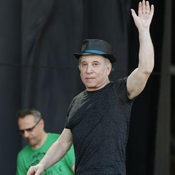 Paul Simon has had to postpone the gig