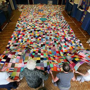 Children and parishioners in Stockport are waiting to find out if they have broken the record for the largest coat yet