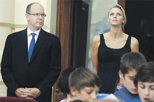 Monaco's Prince Albert II and his fiancee Charlene Wittstock looked pensive while attending the Saint Jean procession in Monaco last week