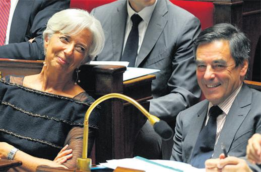 France's Finance Minister Christine Lagarde, left, speaking with Prime Minister Francois Fillon at the National Assembly in Paris yesterday