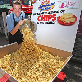 Head of catering James Gibbs smiles after breaking the Guinness World Record for the biggest portion of chips ever served